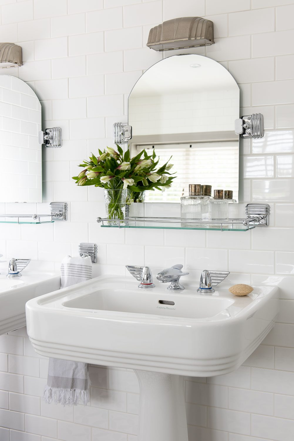 The bathroom, put in by the house's owners, features a pair of striking Art Deco-style basins and mirrors, with Chrysler-style taps by Lefroy Brooks