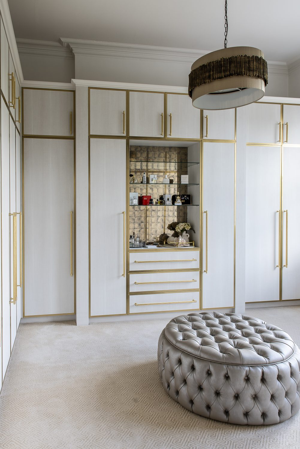 Beyond Joinery in London created with Xylocleaf panels and polished brass edges in Olya's dressing room