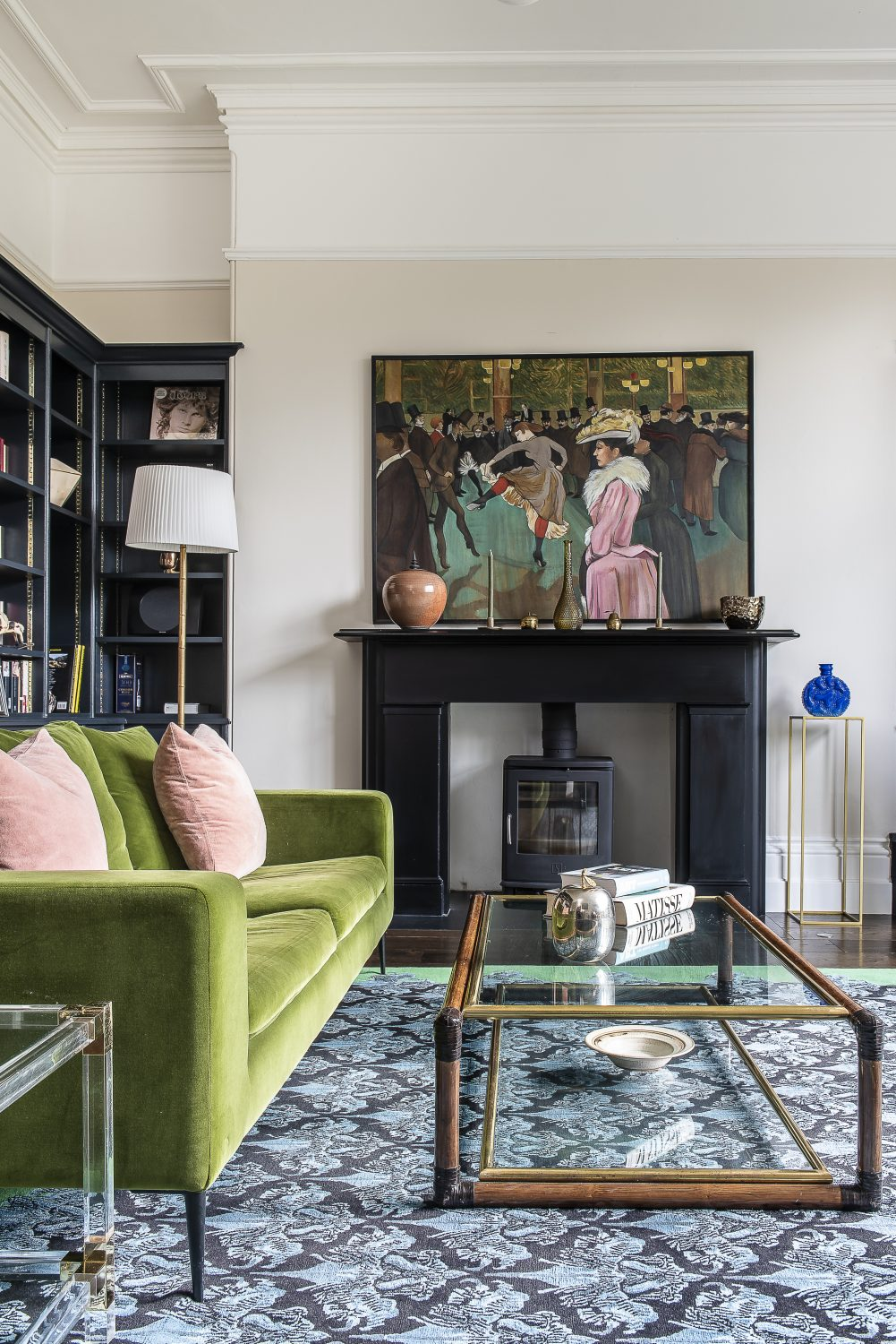 The focus in Olya's husband's study is a piece by the artist Louis Midavaine, a copy of one of Toulouse Lautrec's Moulin Rouge paintings from the 19th century. A rug from The Rug Company and a bright green Conran velvet sofa compliment the painting's palette