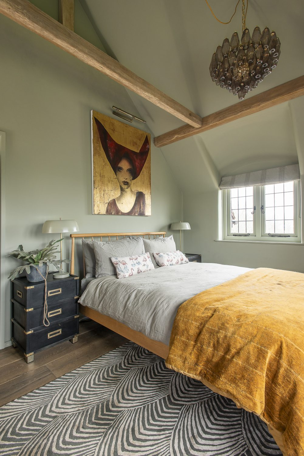 The staggering gold portrait hanging above the bed was accidentally cut in two by the builder, then thankfully salvaged by the artist