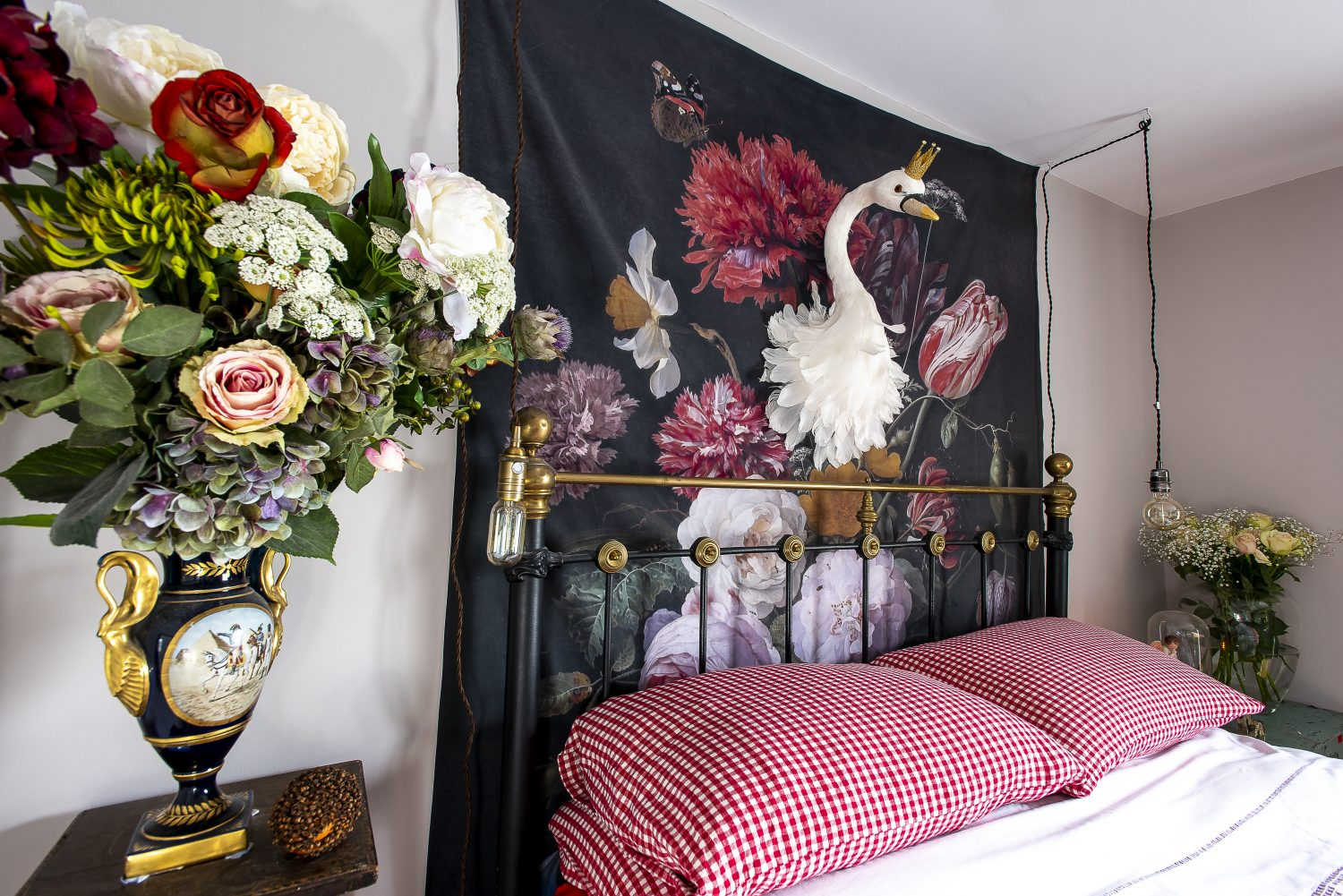 Sally's bedroom. An oversized wall hanging of flowers, from which a swan protudes, adds to the fairytale feel