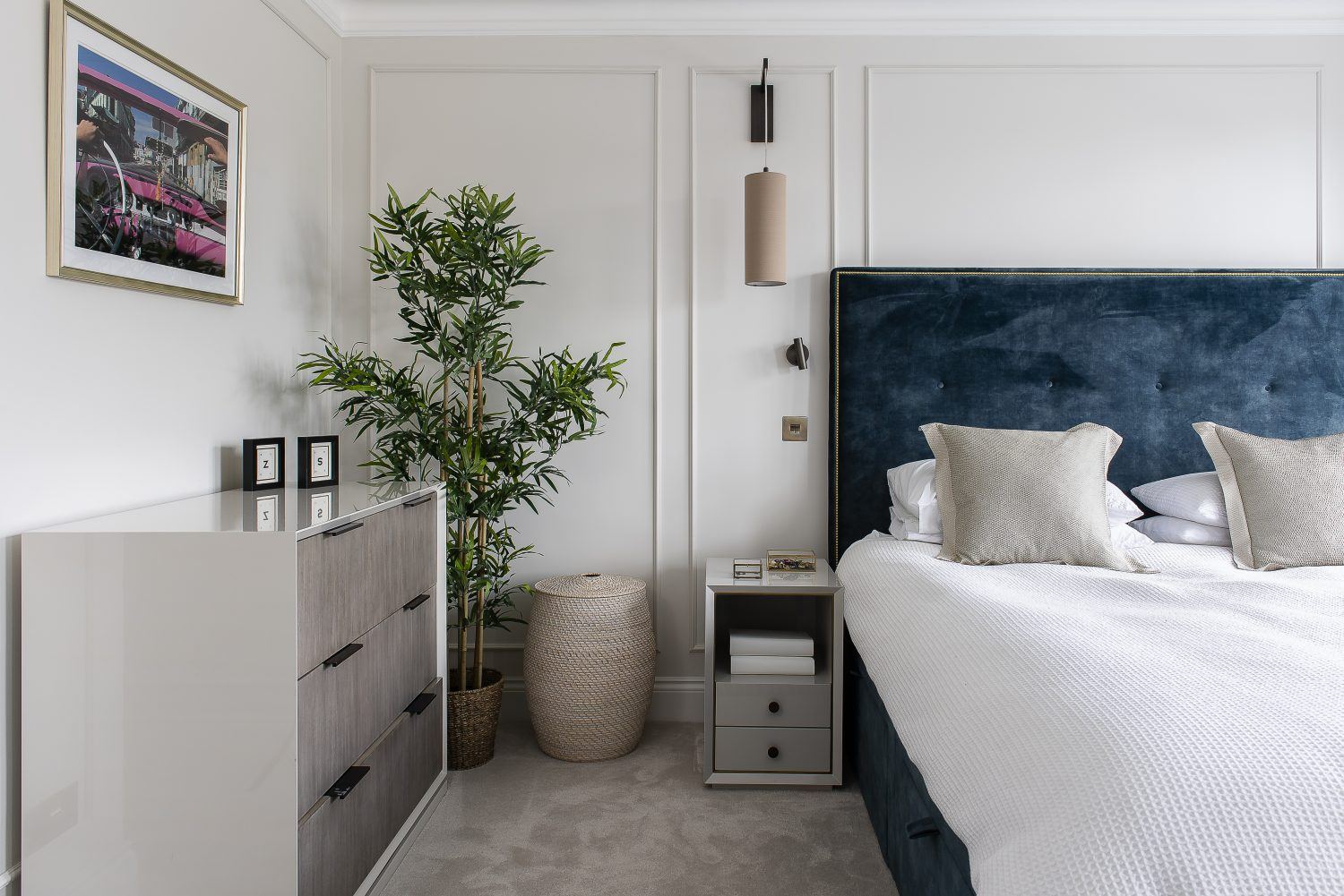 On her husband's request, Zoe created a master bedroom with a true hotel feel with beaded panelling, a velvet bed – from Sweetpea & Willow – and luxurious bedside tables from Robert Langford, lined in velvet. The lights are by Astro Lighting