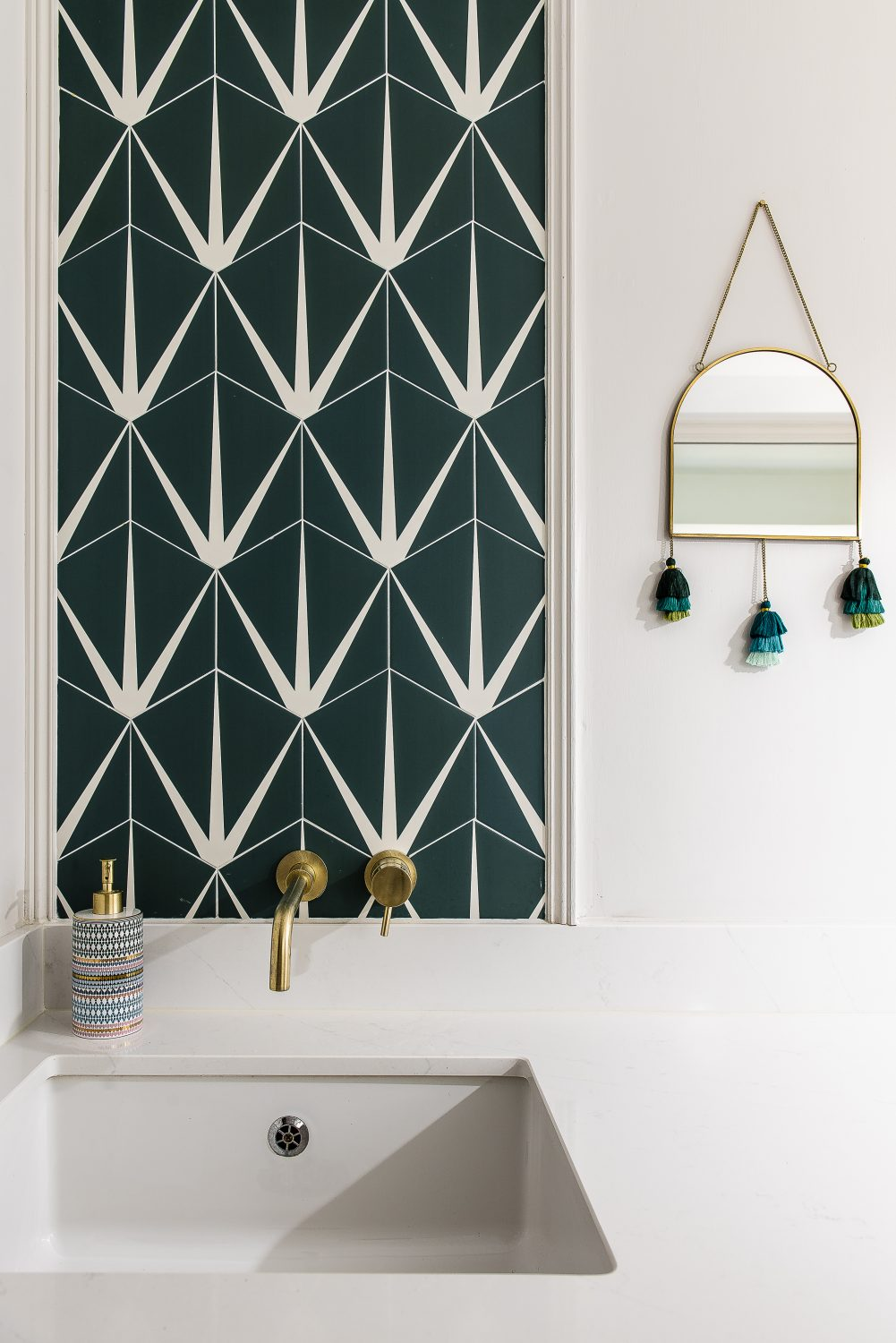A panel of tiles by Artisans of Devizes in the utility room