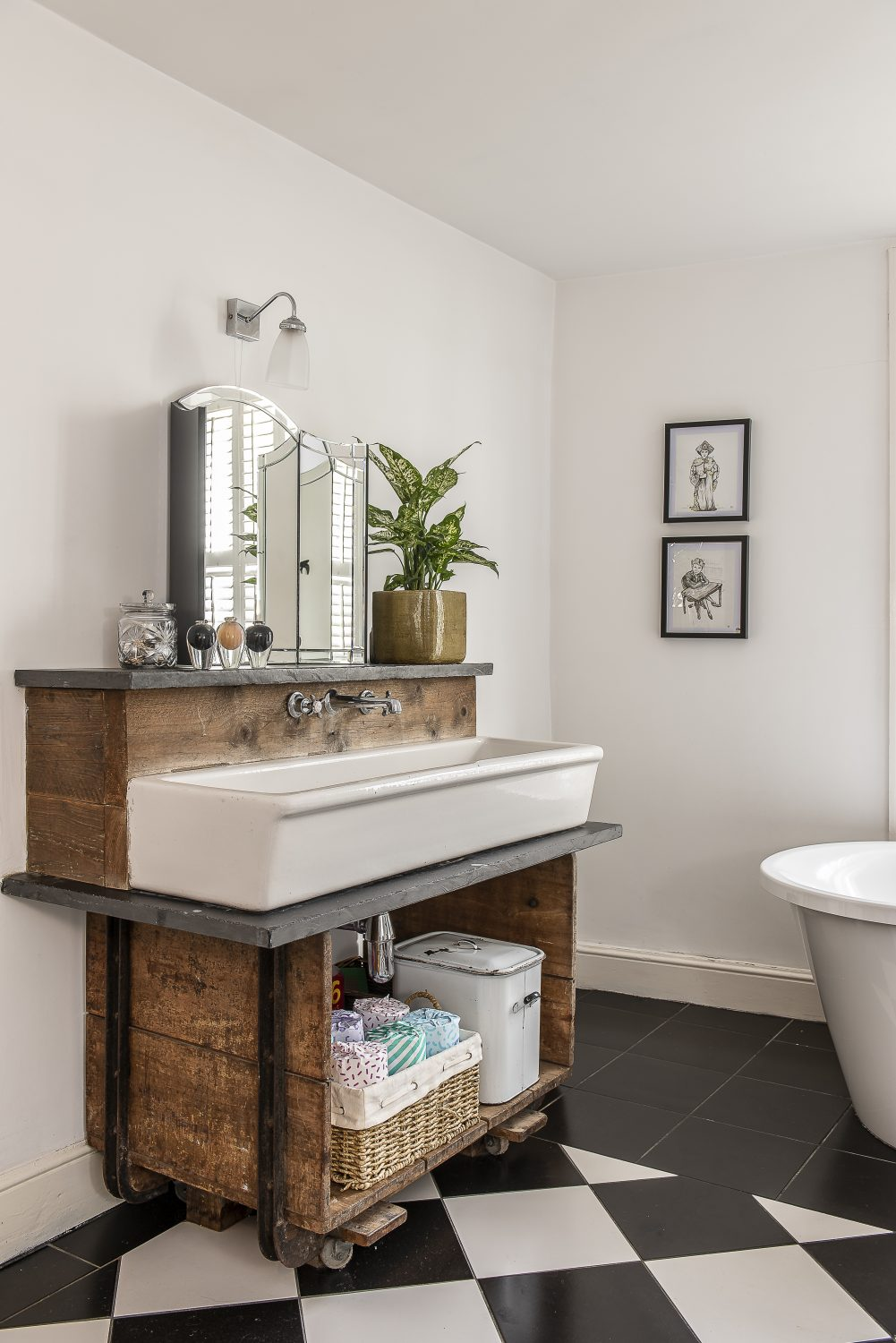 The family bathroom's bespoke vanity unit was created from an eBay find sink, a metal trolley from Rusty's Reclamation, some scaffolding boards and a chunk of slate