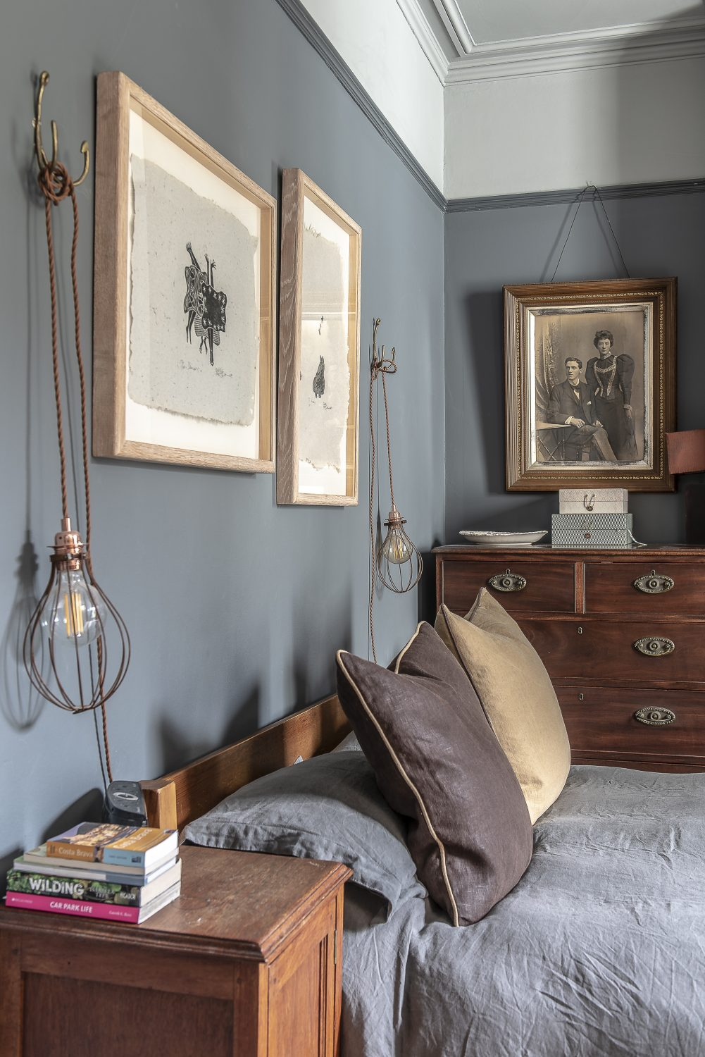 Sadie's own bedroom is decorated in a palette of dark and light greys, golds and leather