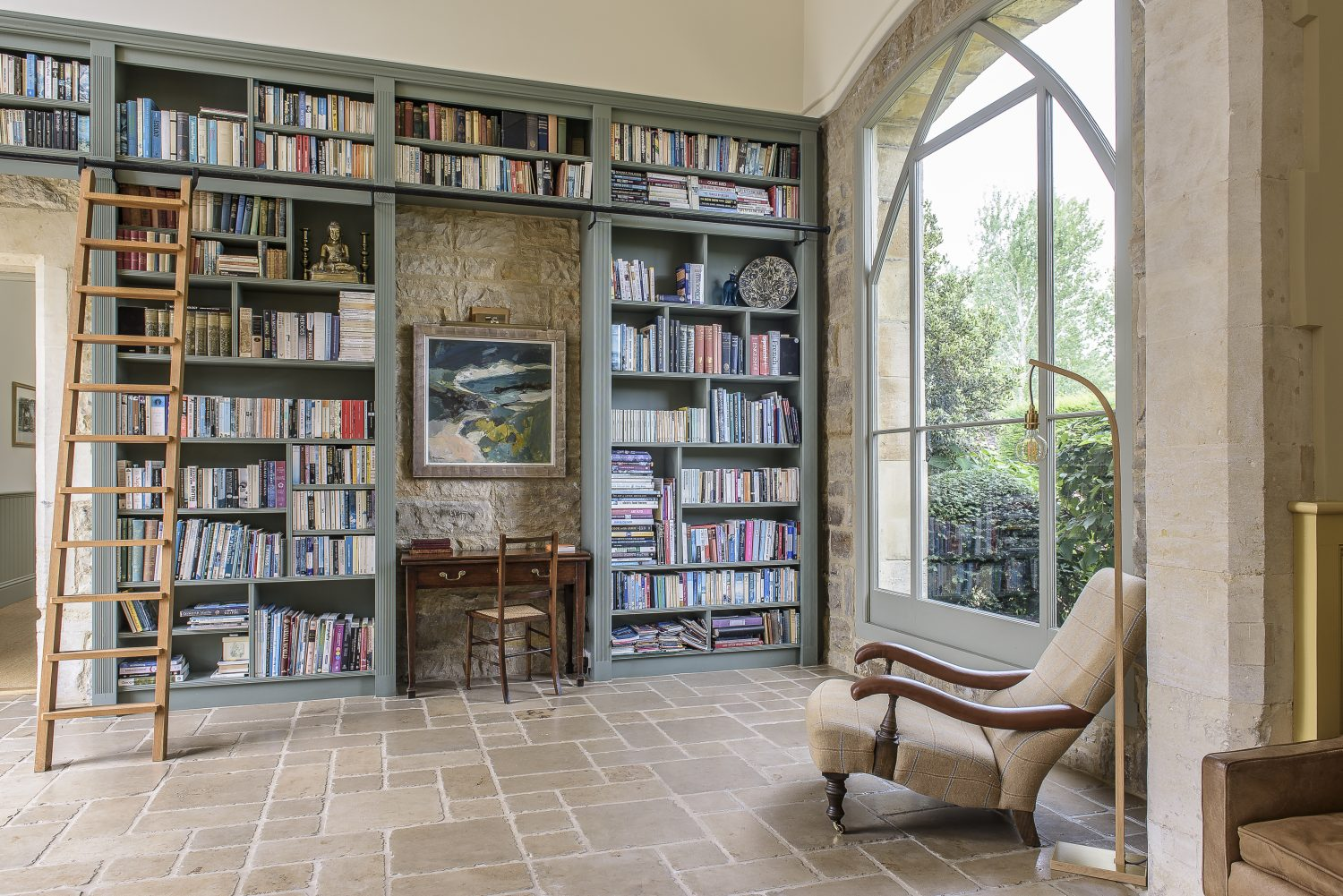 Floor-to-ceiling bookcases offer the perfect opportunity for guests to select a book to curl up with in front of the fire in the room next door