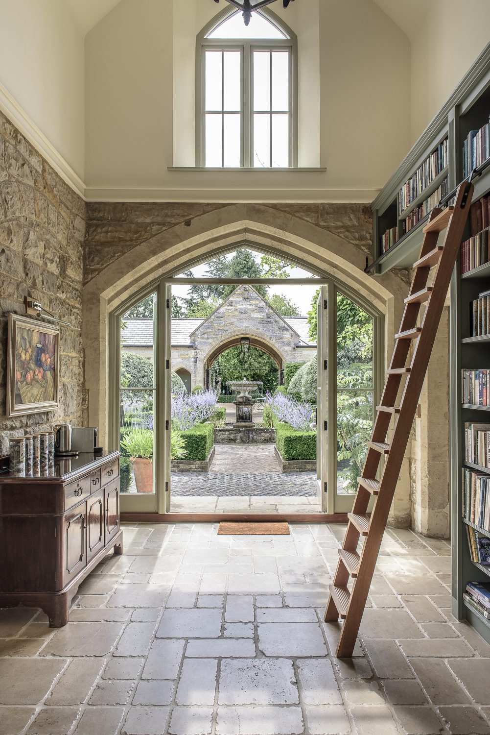 This area has a very high ceiling – it was once the hay loft – and French windows at either side, looking out to the courtyard one way and the garden the other. The perfect spot for guest breakfasts when it's not warm enough to be outside.