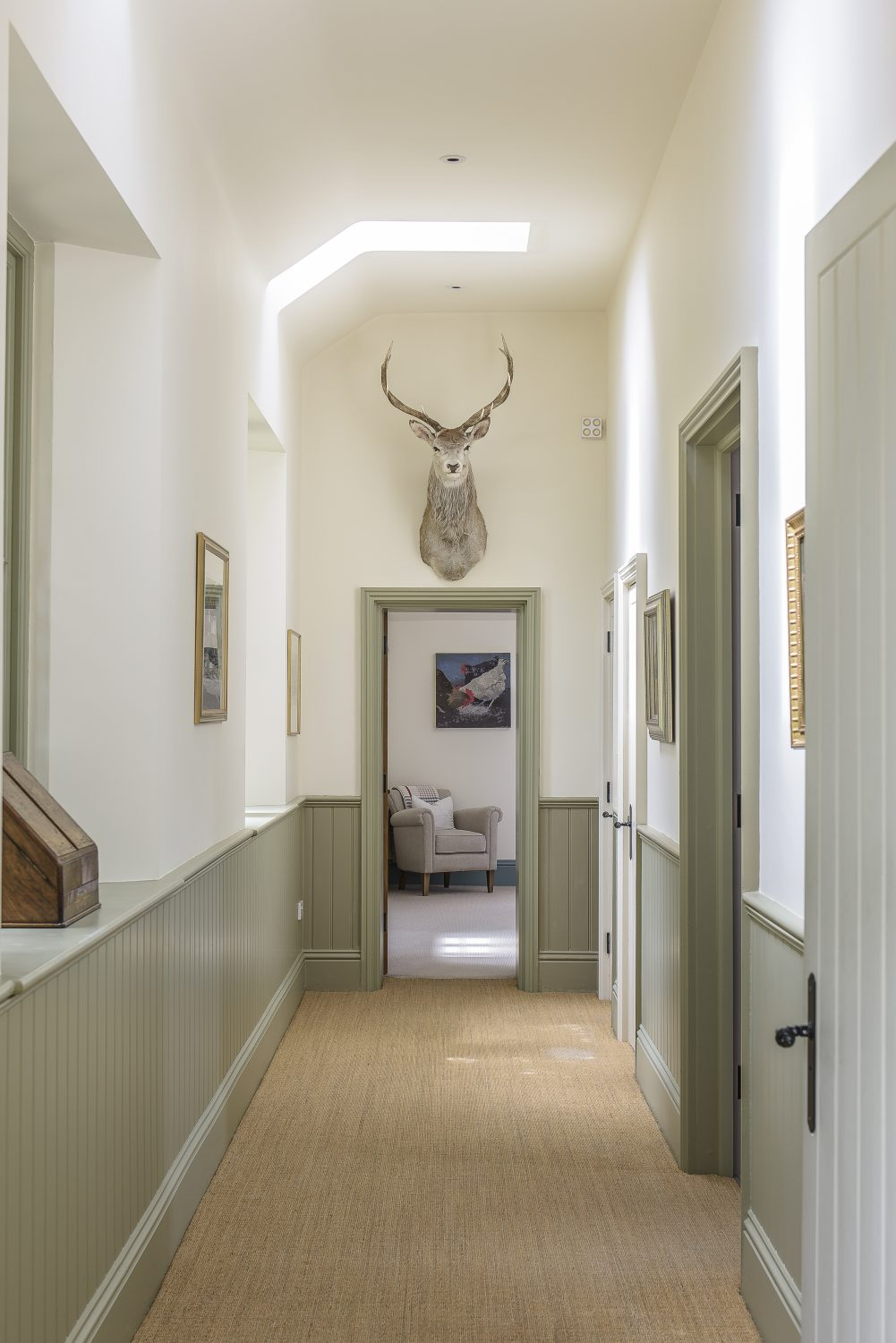An airy corridor leads to the guest wing's two bedrooms