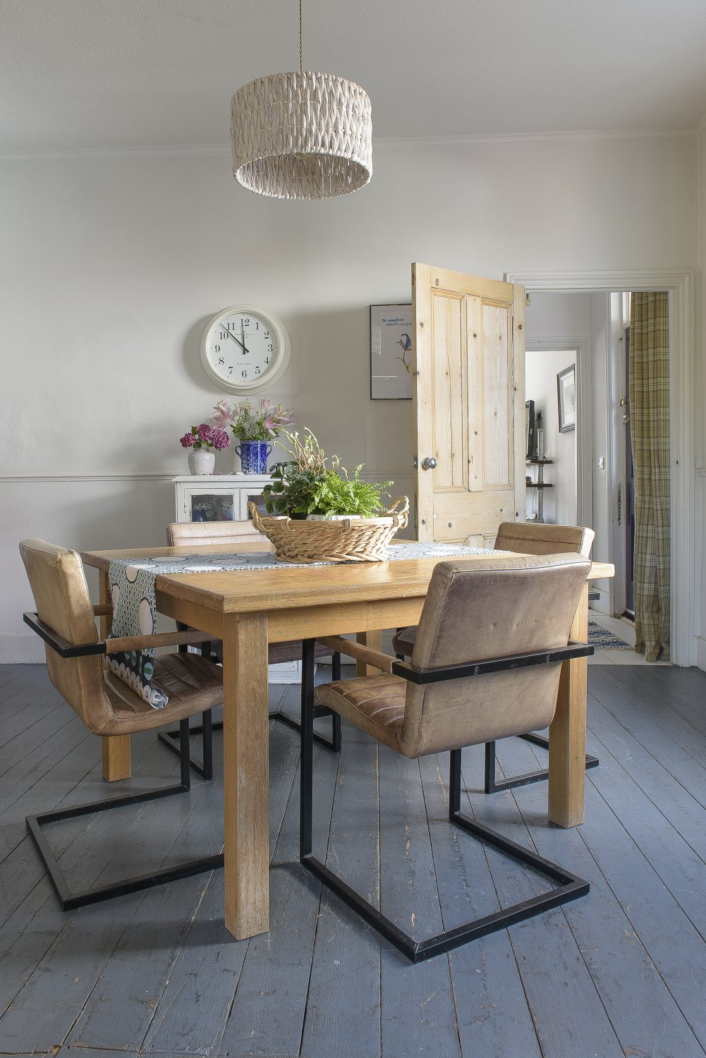 Setting the dining table at a diagonal angle makes it much easier to get around the room and adds dynamism to the space