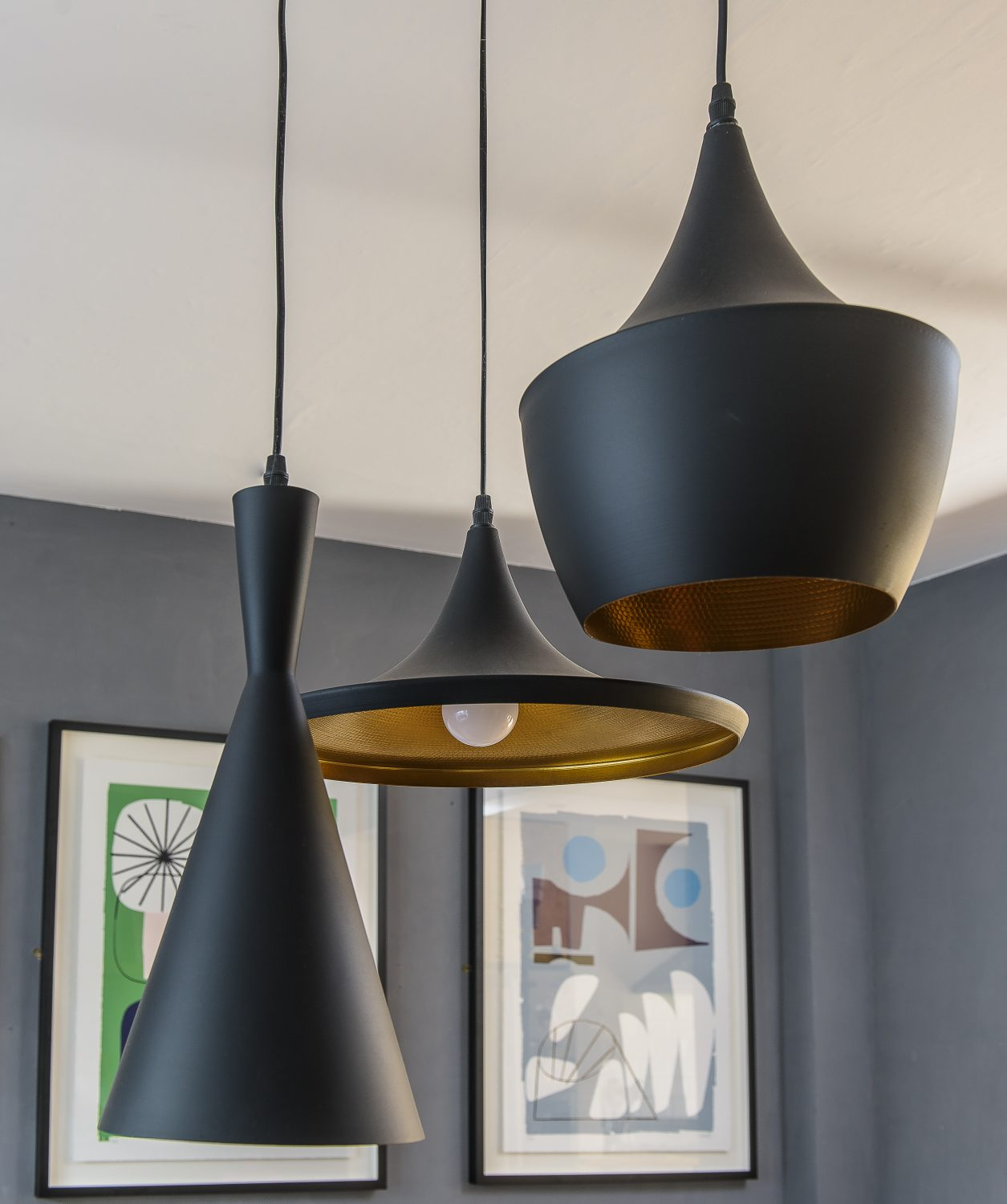 Metal pendant lights, grouped above the dining table, are from Dwell