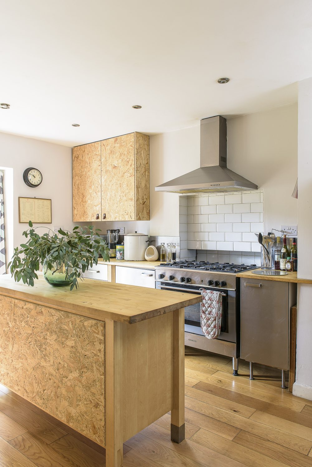 Jules and Ollie decided to keep the IKEA kitchen that was in place when they bought the house, upgrading it to suit their taste with the addition of doors made from OSB.