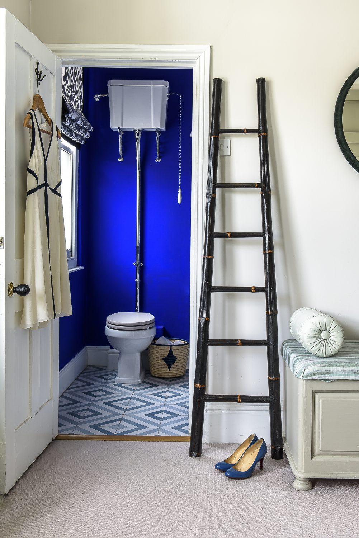 The en suite bathroom is painted in 'Ultra Blue' by Little Greene