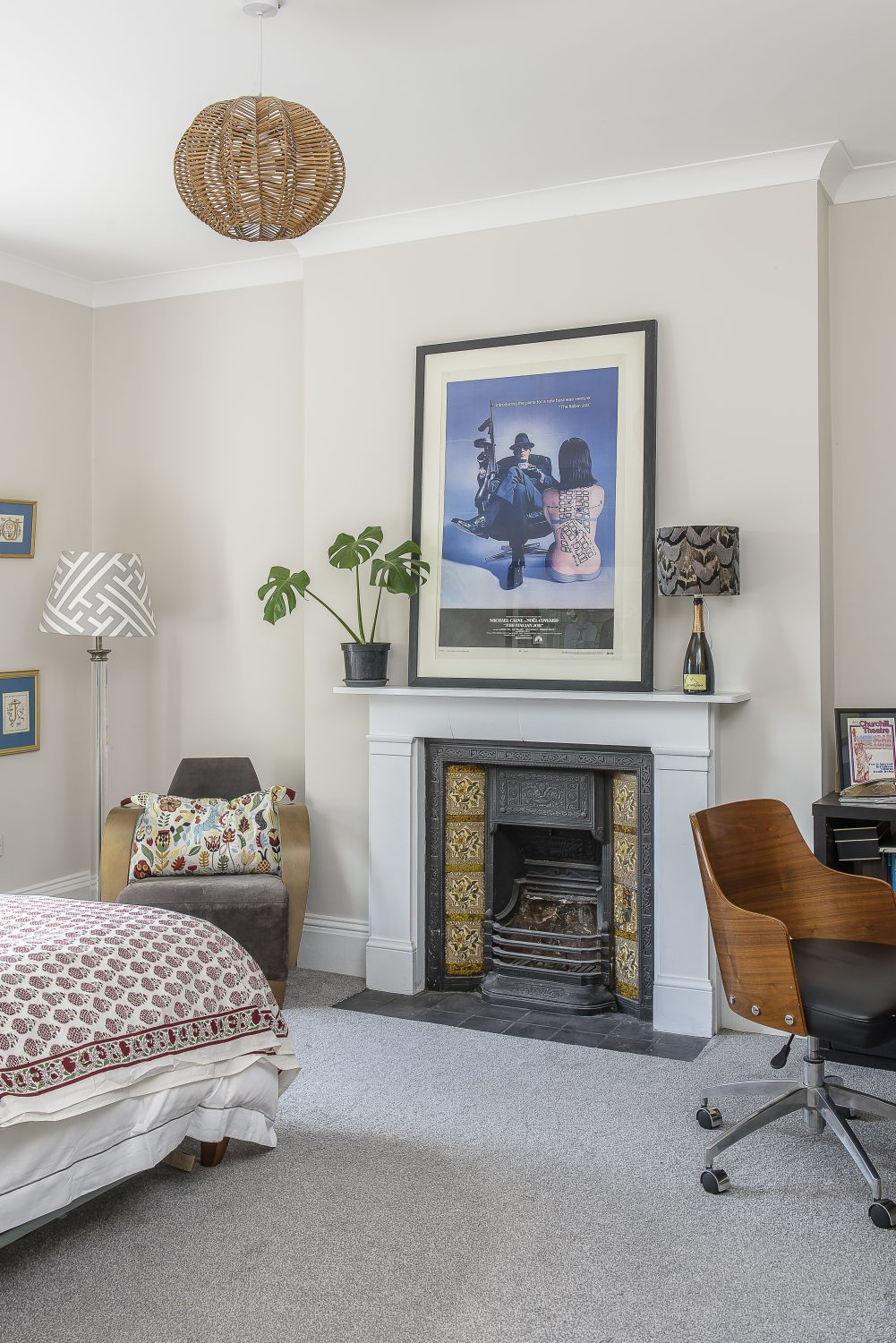 The guest bedroom is a calm haven, with walls painted in Farrow & Ball Strong White and a pleasing mix of fabric designs and colours provided by the upholstered headboard, soft furnishings and lampshades made by Jules – proving that pattern doesn't always have to match
