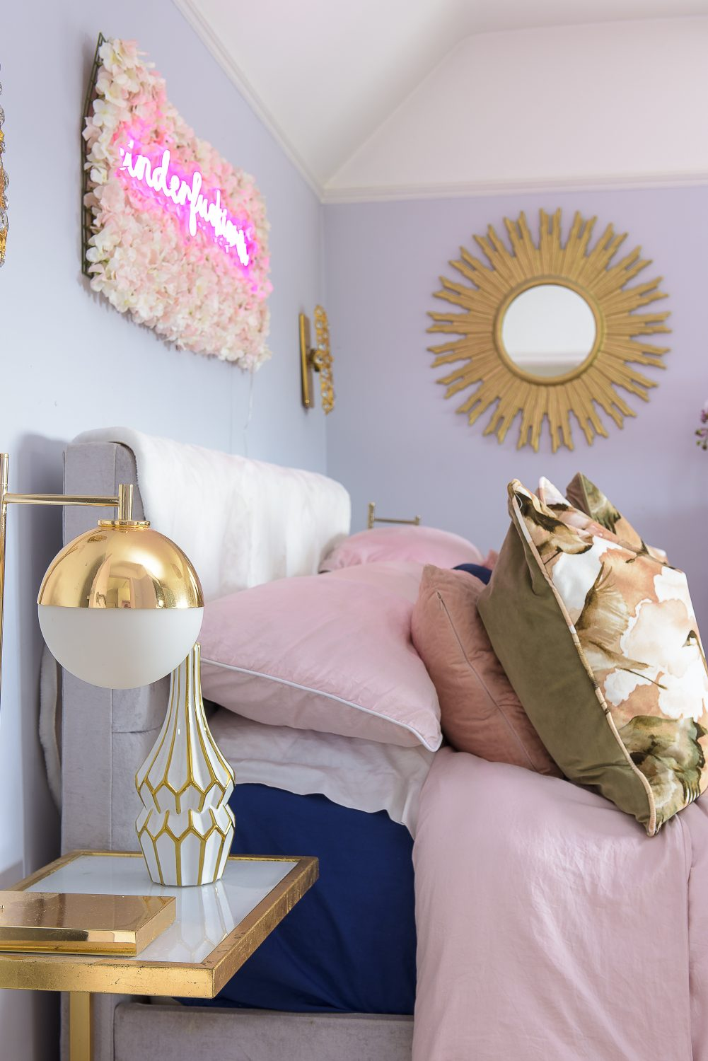 Gold and white orb lamps, found at HomeSense, are a feature throughout the house, this time in the form of bedside lamps in the master bedroom. The cushions on the bed are a heron print by Feather & Black