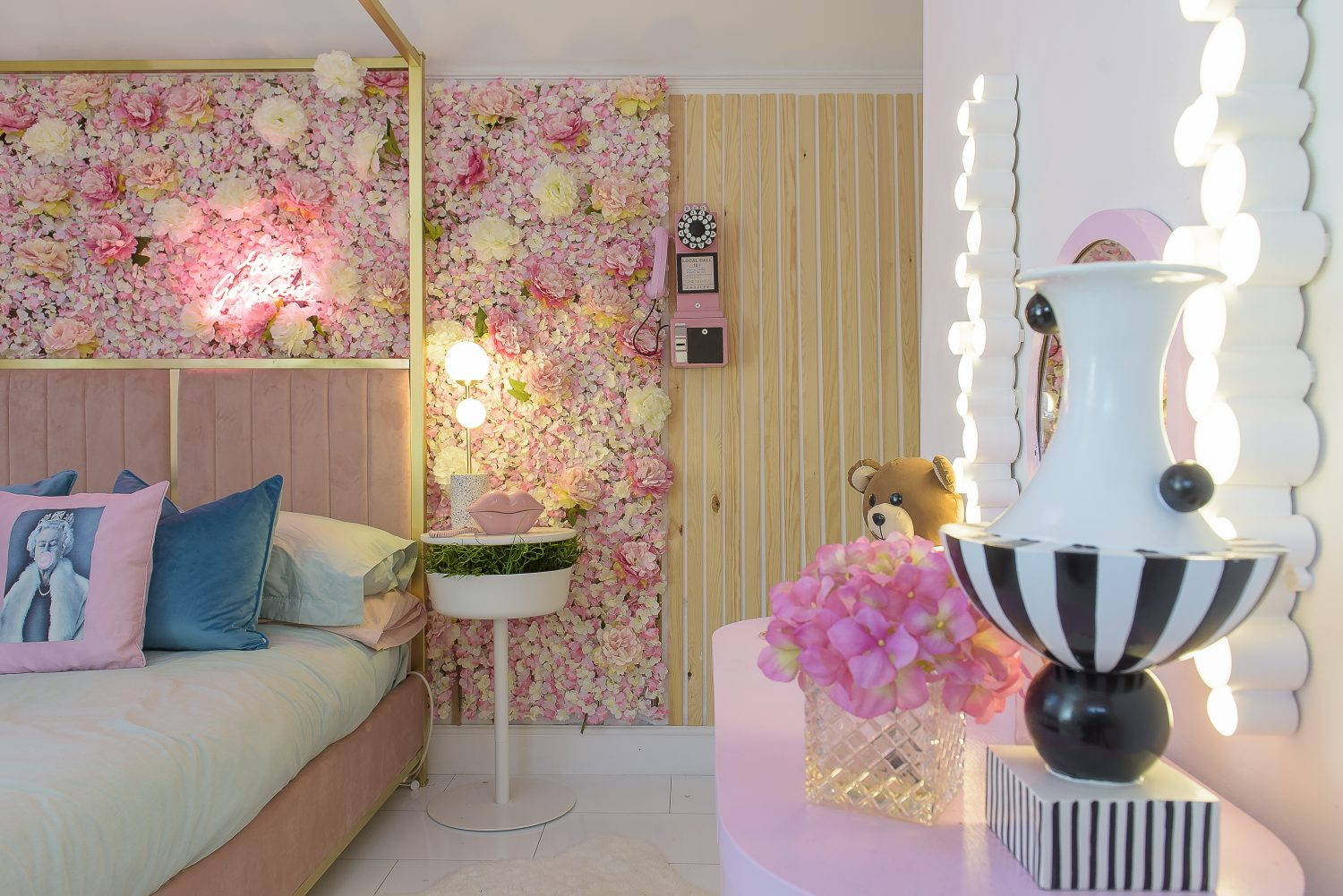 Cat's youngest daughter's bedroom has been her most recent project. With a brass four-poster bed and a wall of pink silk flowers, she chose the room's decor inspired by the interiors of MaMa Kelly's pink restaurant in Amsterdam and the Peggy Porschen cake parlour