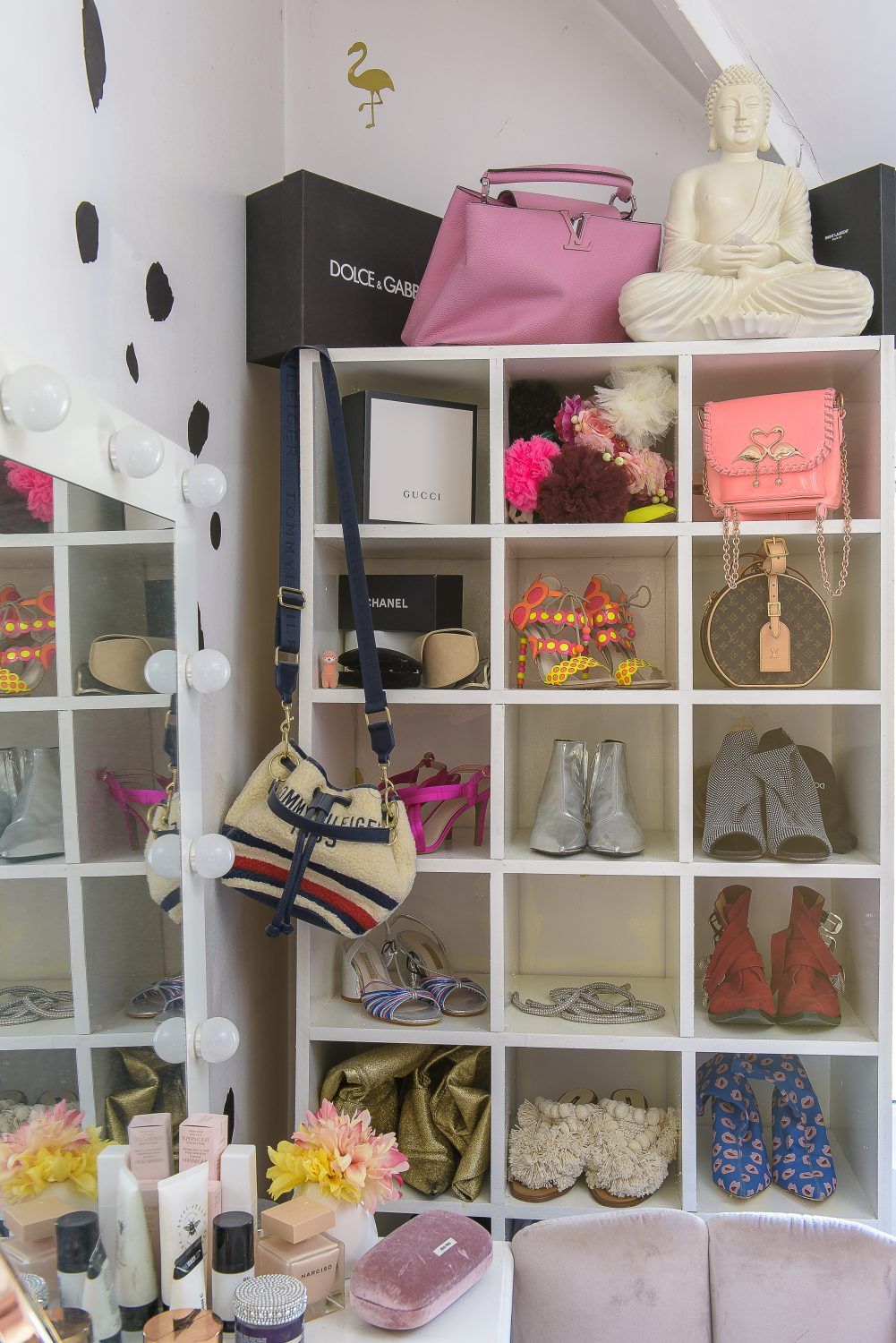 Cat's dressing room houses her extensive collection of quirky bags and shoes