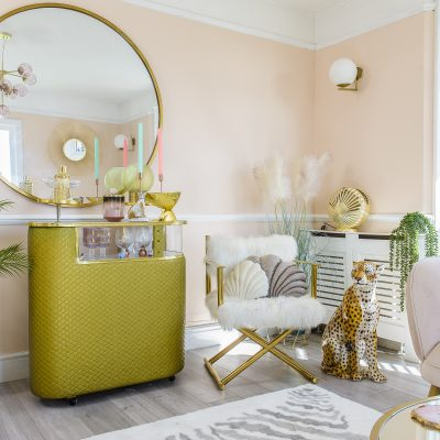 The sitting room is home to a quilted gold cocktail bar – a vintage find from Margate, sourced via Instagram. With a core palette of blush pinks and gold, Cat brought many of the room's decor back from her shopping trips to HomeSense
