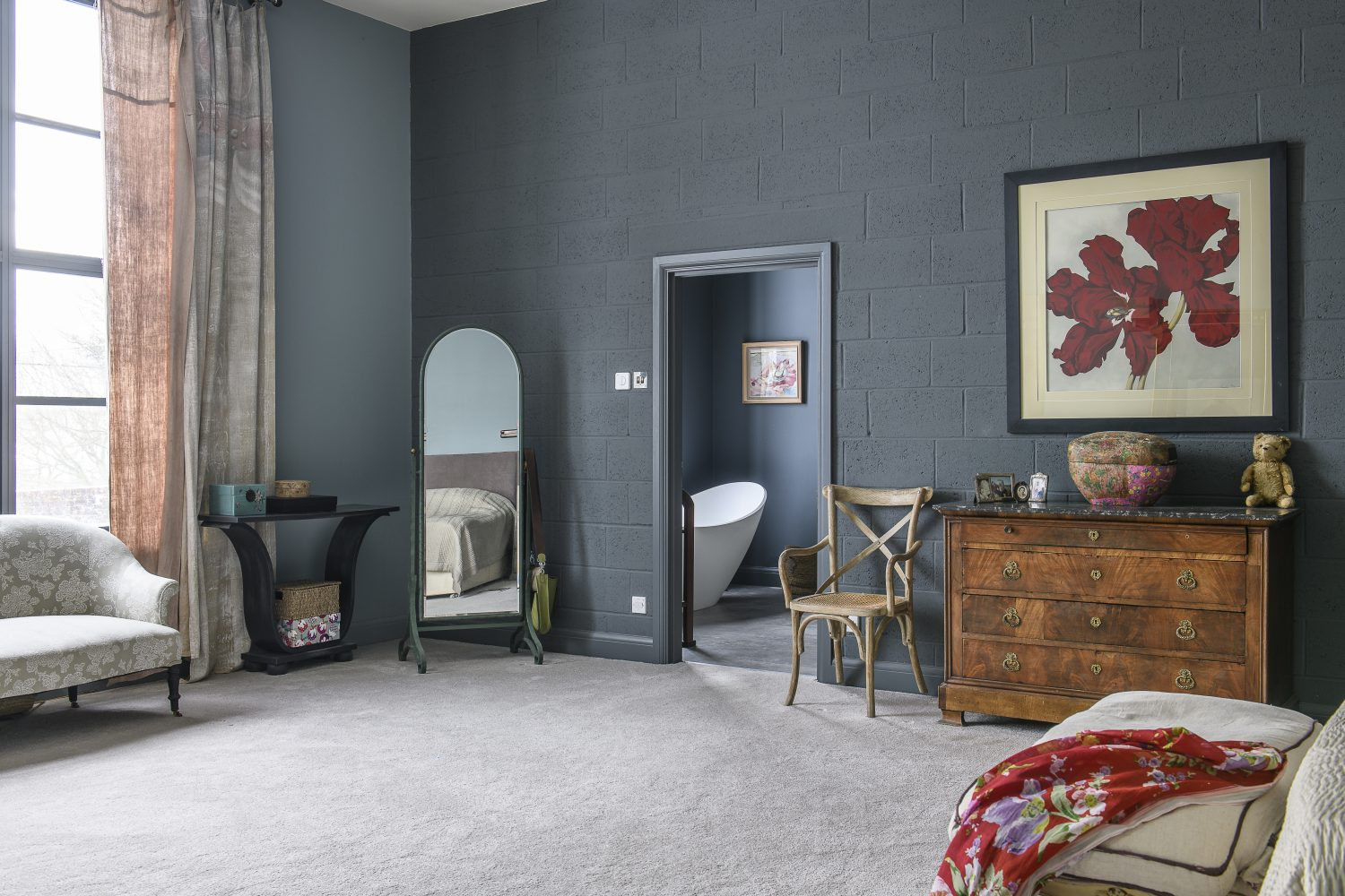 The master bedroom's walls are painted a deep grey – Shetland by Zoffany