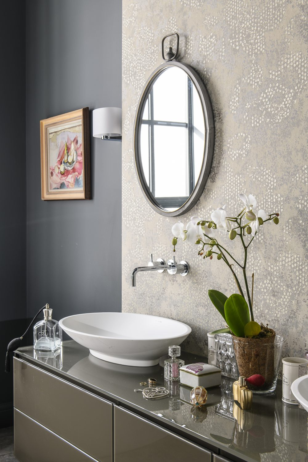 A luxurious, sculptural bath from C P Hart in Tunbridge Wells reclines next to the curtain-less window in the bathroom. The walls are painted in Scree by Little Greene, with wallpaper by Designers Guild
