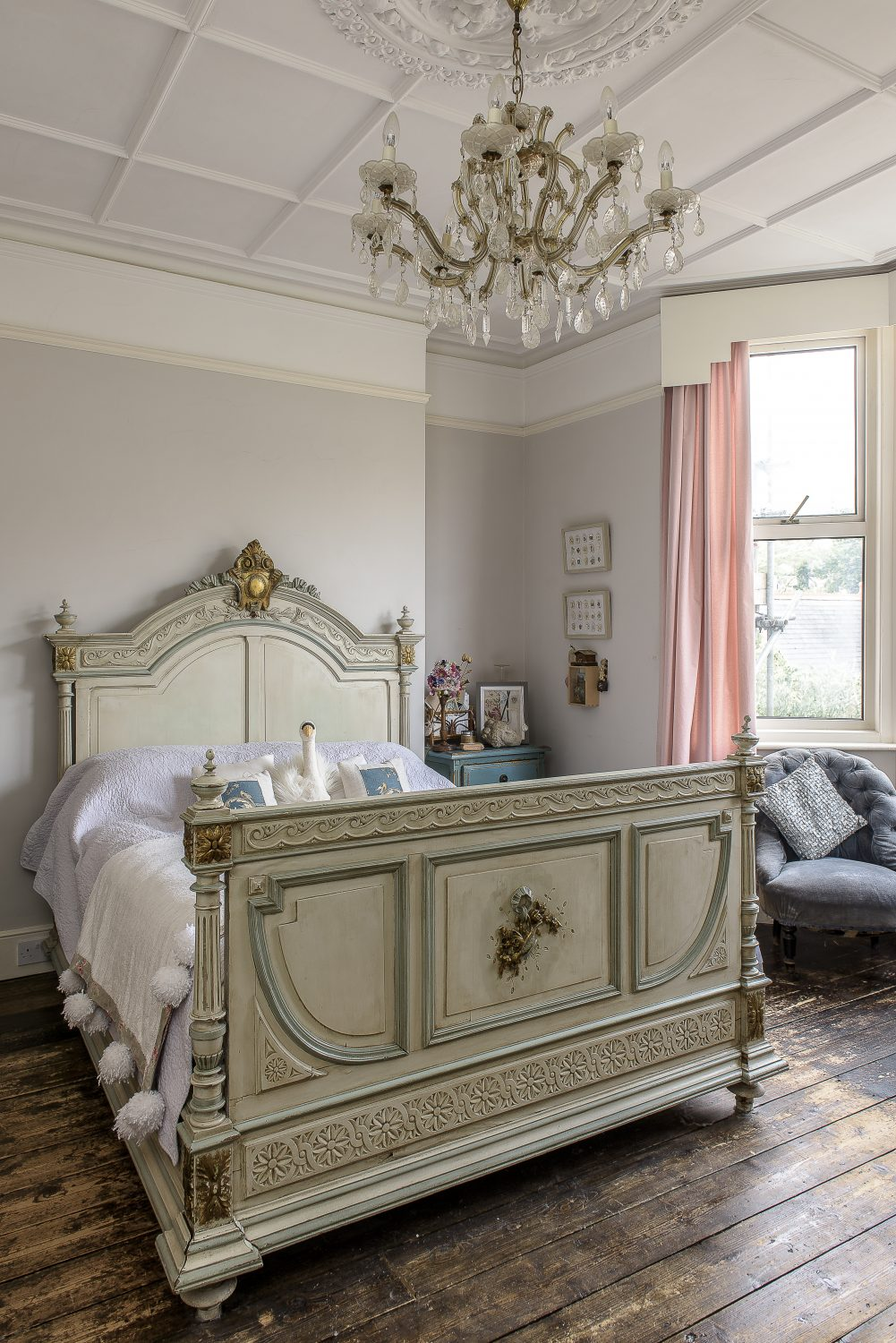 With stripped back, bare wood floors a feature throughout the house, this bedroom is softened with layers of cosy quilts and plump cushions