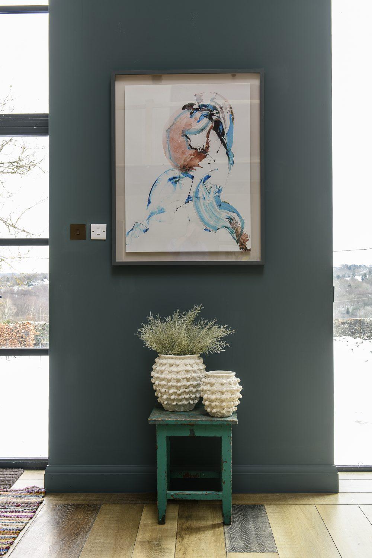 Artwork by Venetia Nevill hangs by the front door