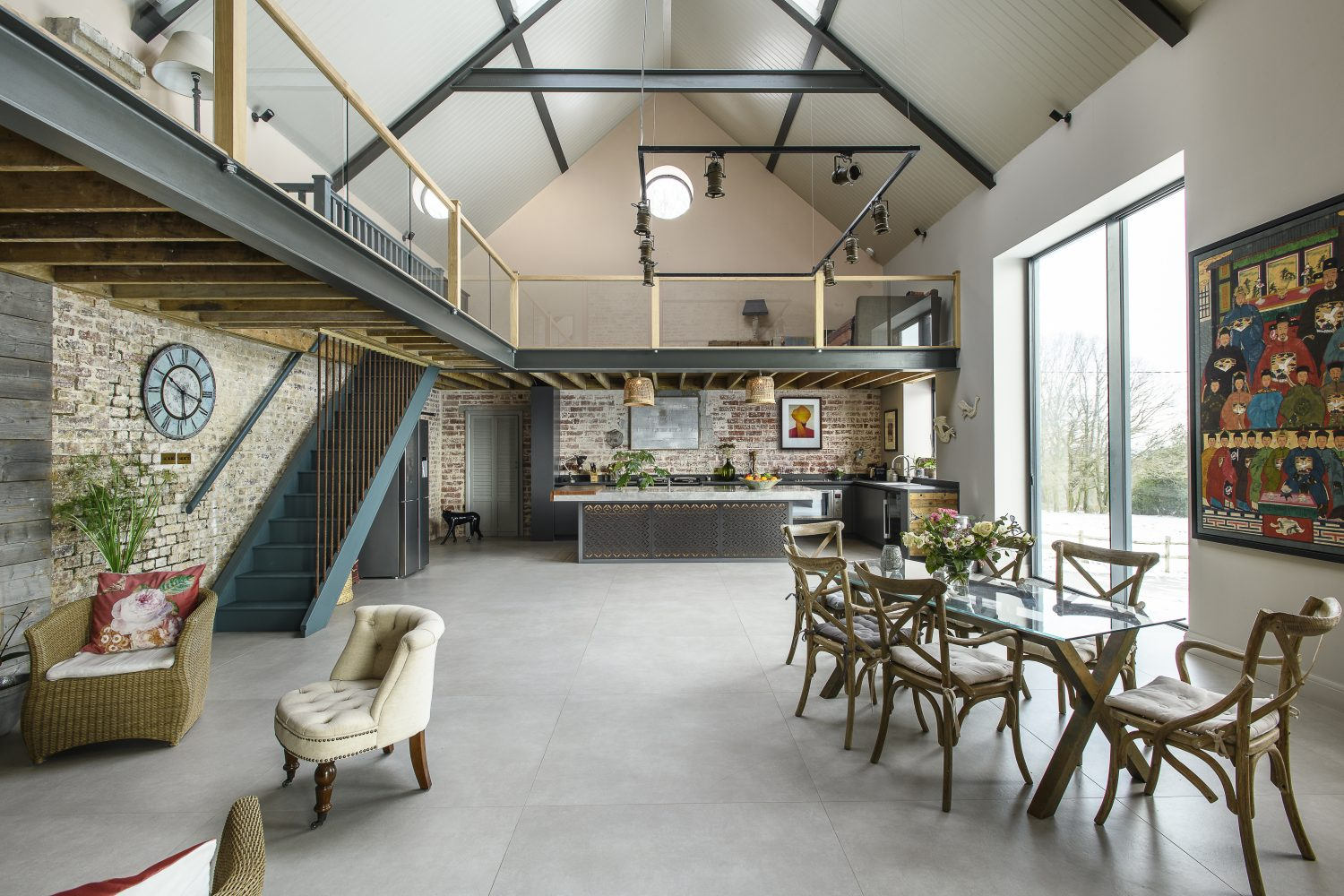 Leading up to the mezzanine, the staircase banisters were made from rebar (the metal rods used to reinforce expanses of concrete), a clever and economical solution suggested by Tom and Dean