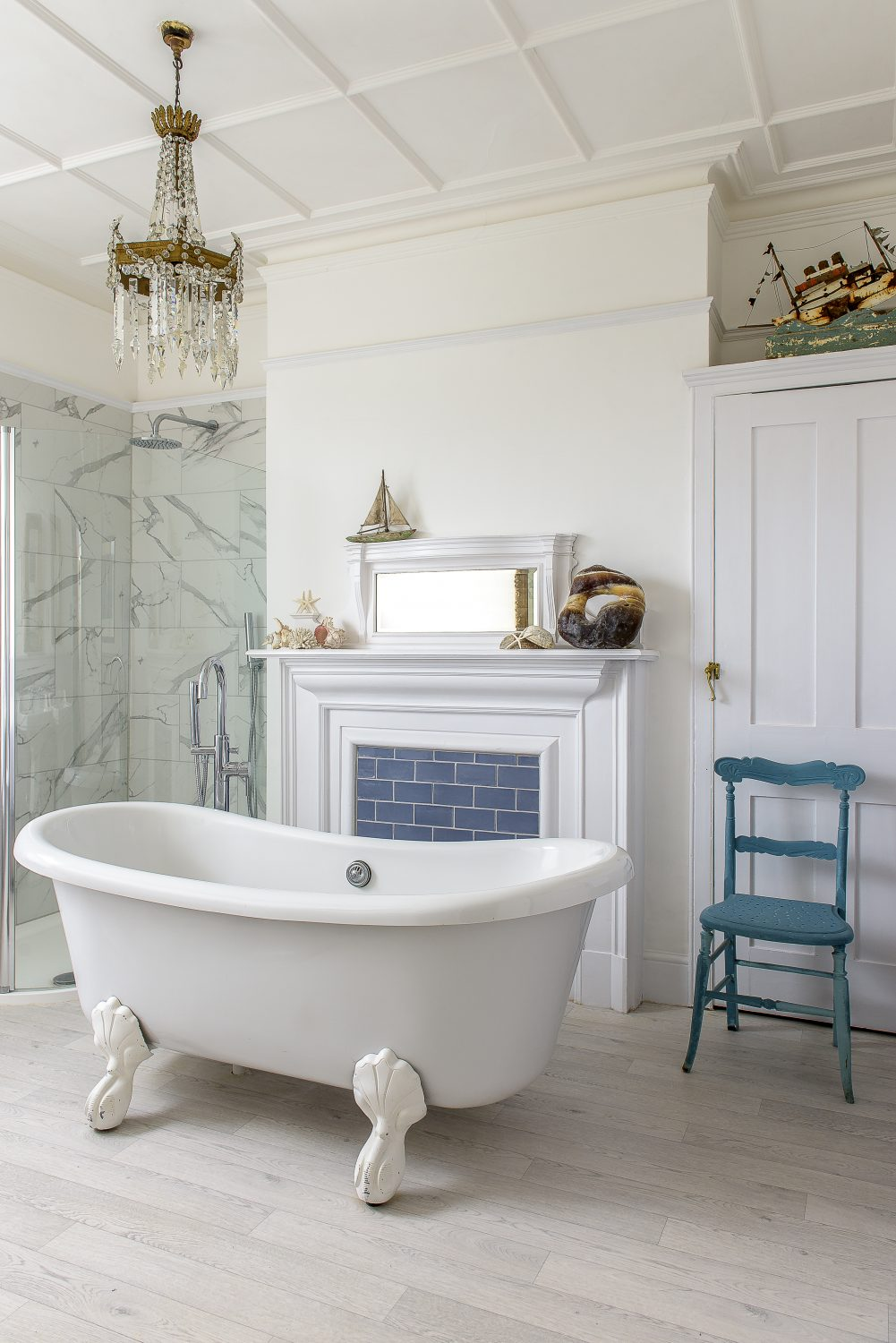 """Susan transformed one of the original bedrooms into a bathroom, retaining the fireplace. Fearing the weight implications of a stand-alone cast iron bath, she found this claw-foot version for £10 on eBay. """"It's resin. Cast iron would have gone through the floor."""""""