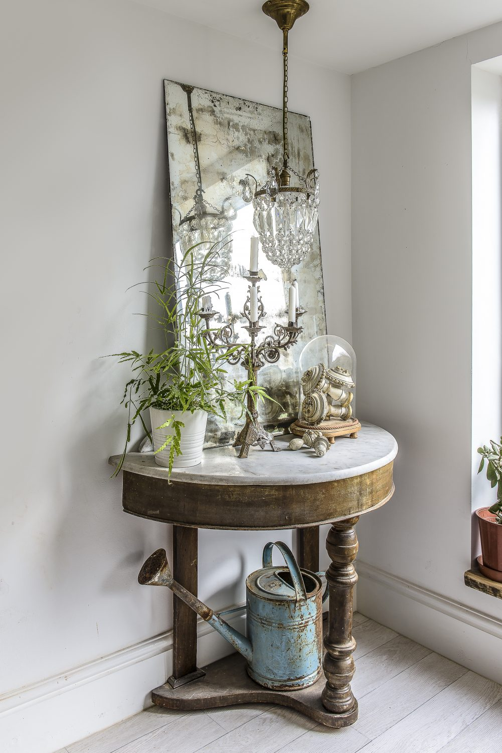 Vintage finds are grouped together on a marble-topped table in one corner of the dining room