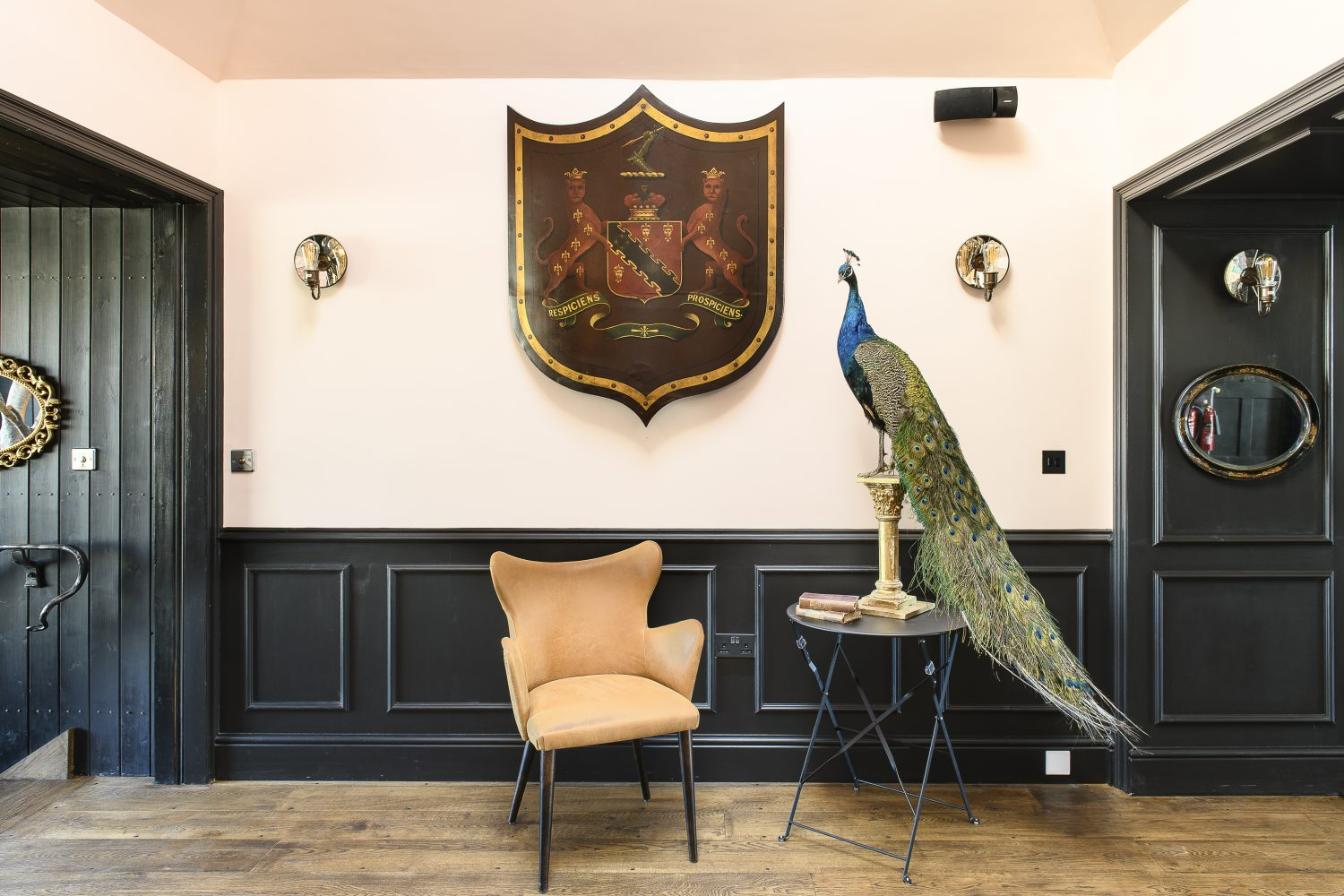 The venue's refurbished interior features a bespoke Melissa White wallpaper and multiple chandeliers alongside a life-size peacock and full height tree