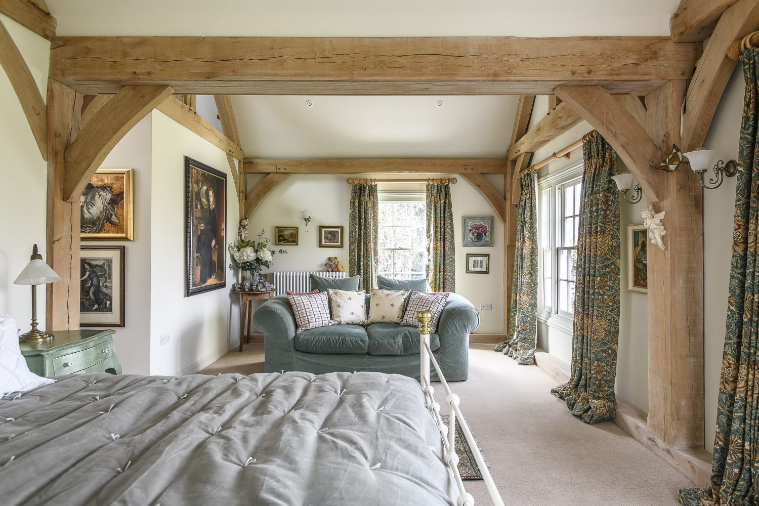 The master bedroom is situated in the two storey extension that Tim and Eve added to the house. The oak frame was made by Paul Cresswell from Sackville Oak Frames, taking around nine weeks to construct in his Kentish workshop, but just three days to install on site