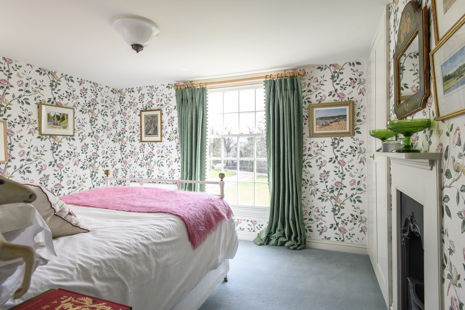 The guest bedrooms are wallpapered in designs by Colefax & Fowler – a lovely floral featuring birds and peonies
