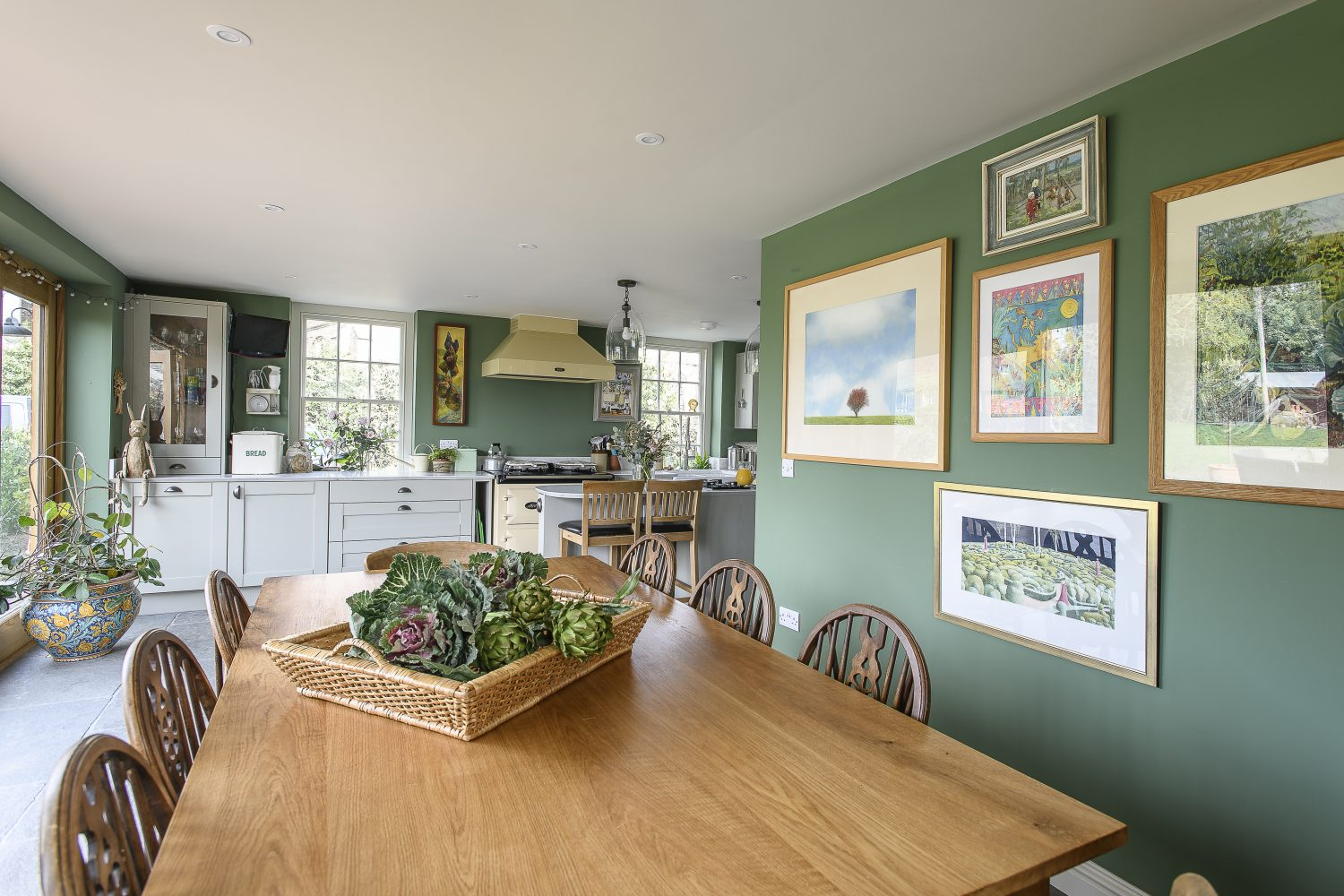 The new kitchen by Howdens spans across the back of the house and opens into the garden