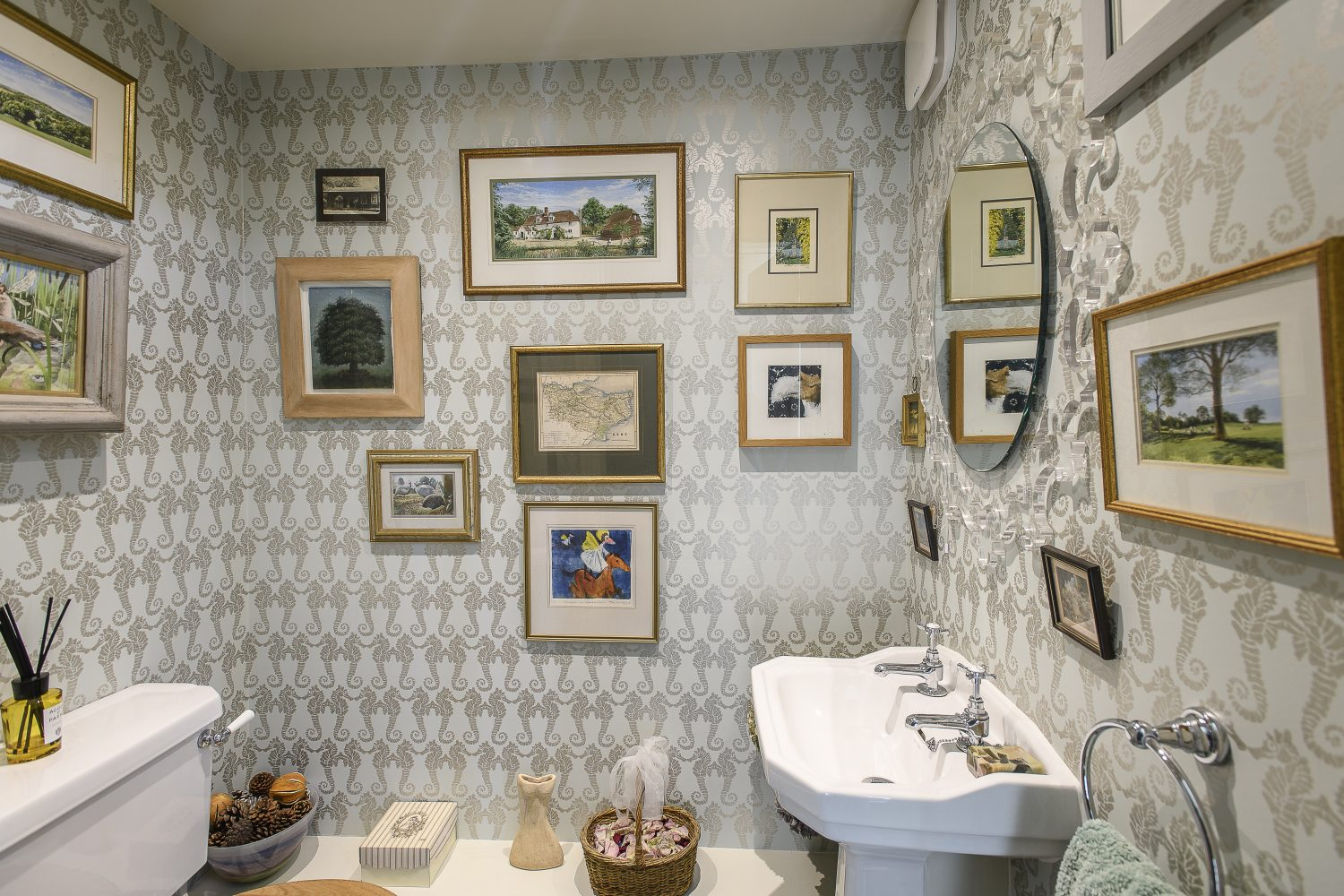 The downstairs cloakroom is papered in Eve's favourite wallpaper – Seahorse by Barneby Gates