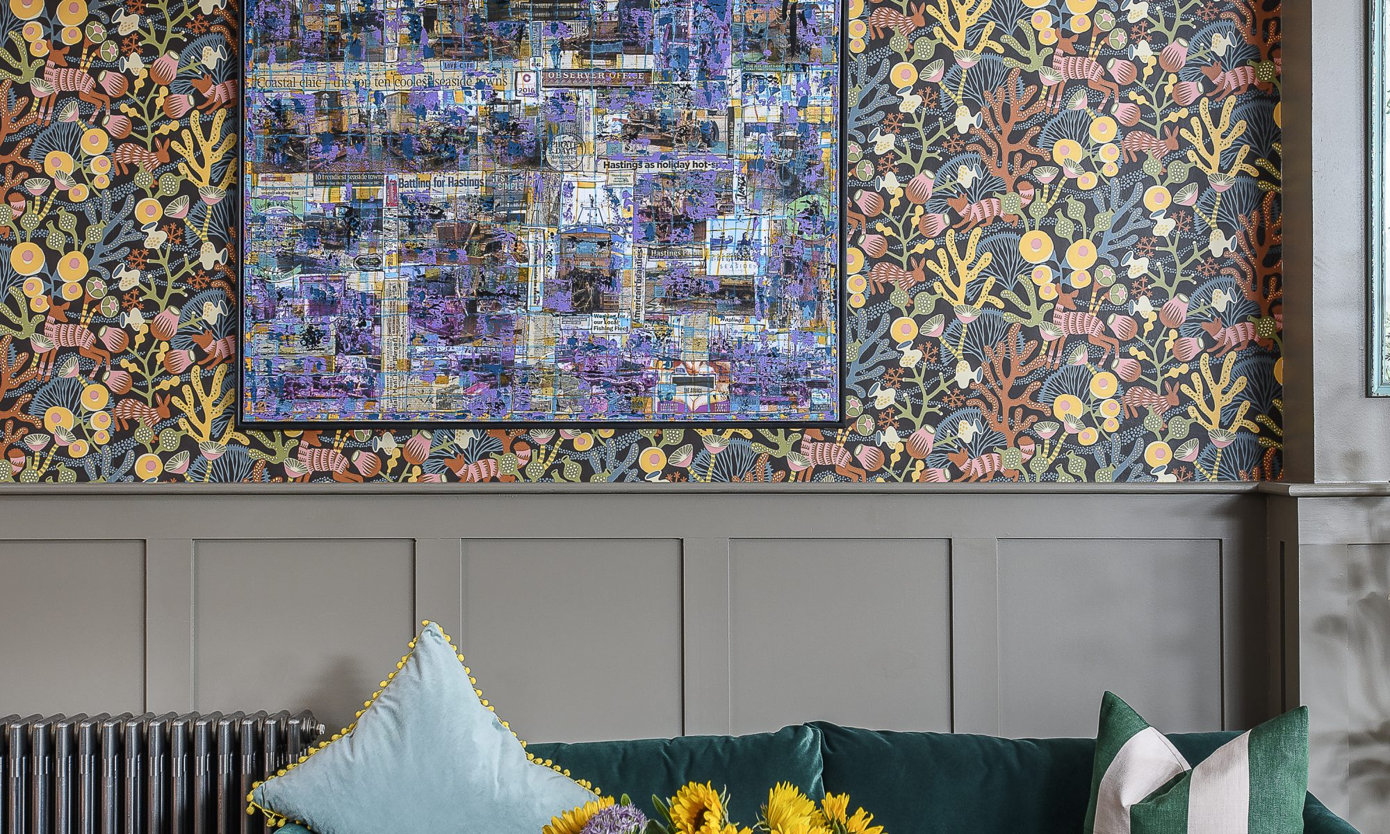 Previous pages & below: Half of the double reception room, set at the back of the building, houses the soft seating area. Charlotte has not shied away from pattern: two different colourways of the same Borastapeter Korallang wallpaper lines the walls here